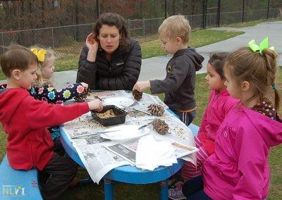 Making pinecone bird feeders with NLI staff