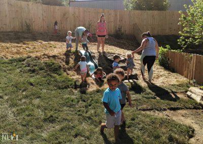 Children enjoy embankment slide